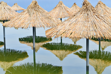 sunshades: Reed sunshades flooded after heavy rains connected with climate changes