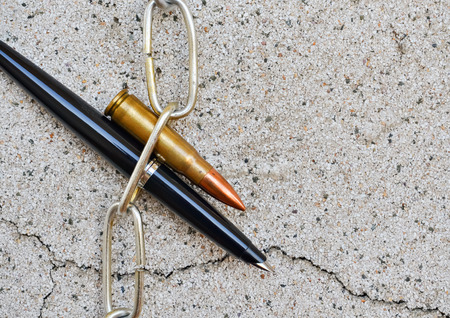 symbolically: Pen chain and bullet symbolically reflect the interests of the world