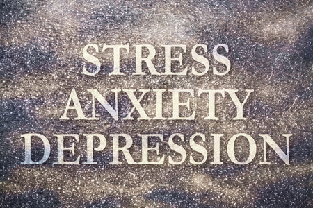 Text Stress Anxiety Depression written on dark background with texture