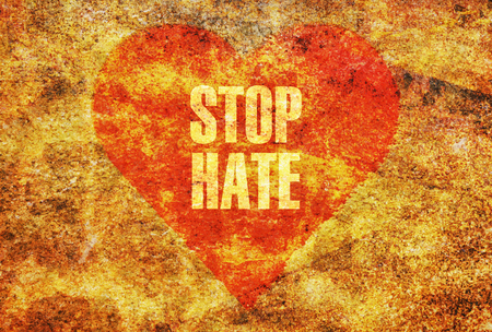 religious text: Text Stop Hate written with golden letters on a red heart Stock Photo