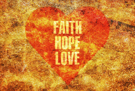 Words Faith Hope Love written with golden letters on a red heart Stock Photo
