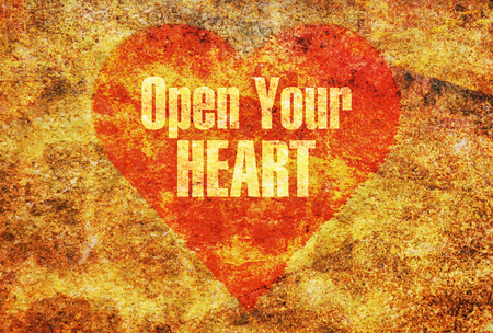 Text message Open Your Heart written with golden letters on a red heart