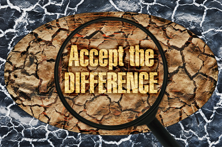bigotry: Text Accept the Difference under a magnifier on abstract background Stock Photo