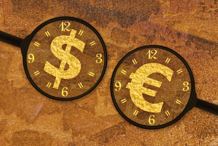 rusty background: Currency symbols under magnifiers on a rusty background