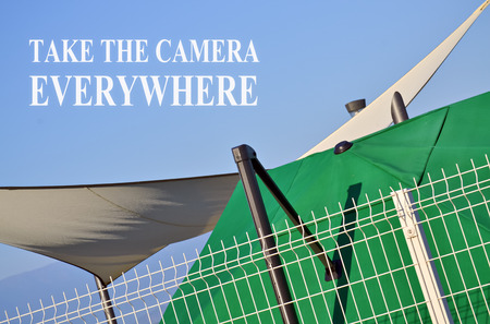 everywhere: Simple composition with text message Take the Camera Everywhere Stock Photo
