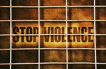 antiwar: Text Stop Violence written on dark background under a wire mesh Stock Photo