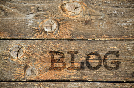 Word Blog written on vintage wooden background with knots Stock Photo