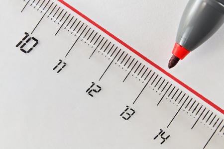 transgression: Closeup of a drawn straight red line and nib of a felt pen