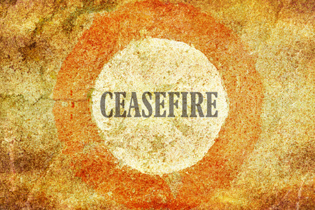ceasefire: Single word Ceasefire written inside of a red circle on textured background