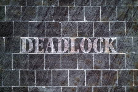 deadlock: Single word Deadlock written on dark textured background Stock Photo