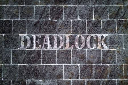 impasse: Single word Deadlock written on dark textured background Stock Photo