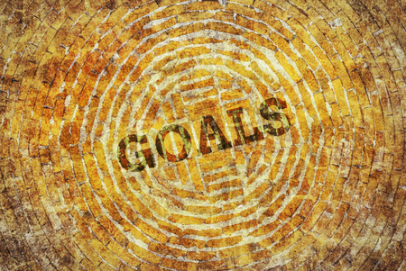 single word: Single word Goals written on a yellow abstract background Stock Photo