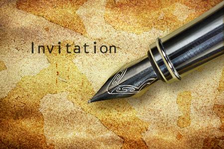 nib: Closeup of the nib of a fountain pen and word Invitation