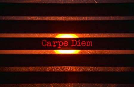 carpe diem: Text Carpe Diem in red and bright sunlight in the background