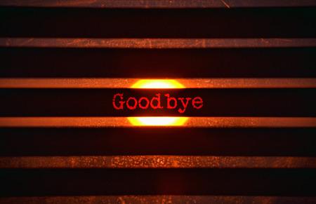 Word Goodbye in rood en fel zonlicht op de achtergrond