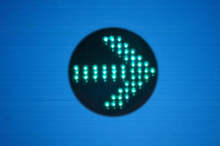 alight: Design of an alight green arrow on vibrant blue background