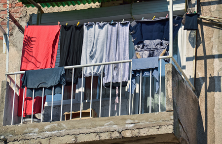 poorness: Drying freshly washed laundry on a clothesline outside the window