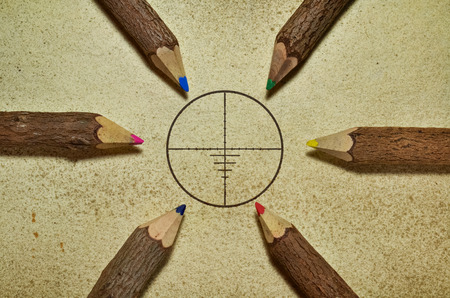 common vision: Target surrounded with pencils on grunge background