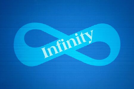 Mathematical symbol of infinity and the word Infinity on blue background Stock Photo