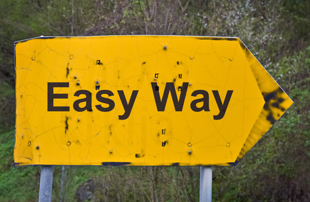 easy way: Text Easy Way written on a yellow road sign