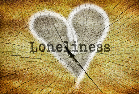 loneliness: Word Loneliness written over drawn broken heart