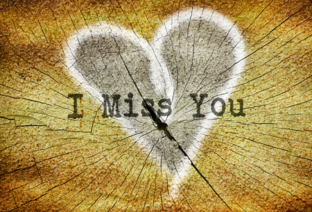 i miss you: Text I Miss You written over drawn broken heart