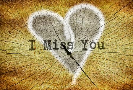 Text I Miss You written over drawn broken heart
