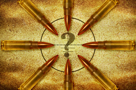 nonsense: Eight bullets aiming in a question mark from different direction Stock Photo