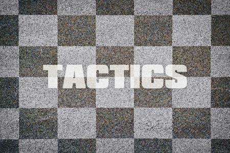 smart goals: Word Tactics written on textured chessboard as background