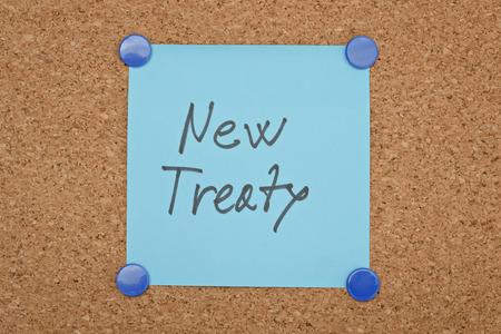 treaty: Text New Treaty written on a sticker pinned on a cork board