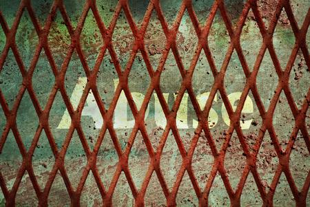 maltreatment: Single word Abuse written under rundown rusty fence Stock Photo
