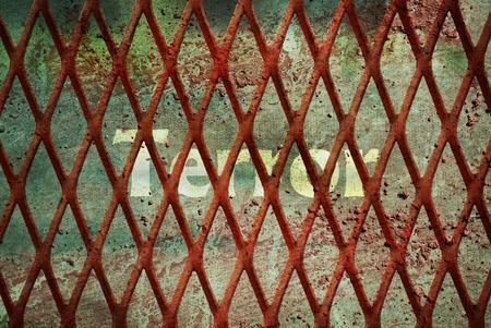 Single word Terror written under rundown rusty fence Stock Photo