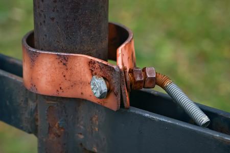 deformed: Closeup of a rusty clamp and big deformed screw