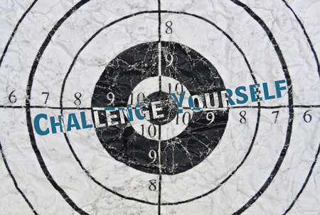 Text Challenge Yourself written in the center of a target Stock Photo
