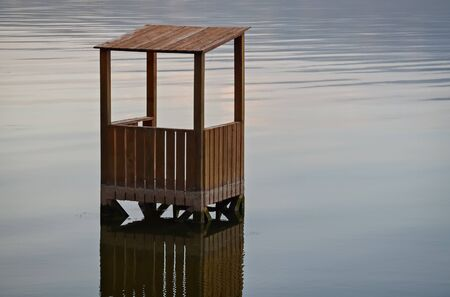 deluge: Flooded wooden construction reflecting in the water