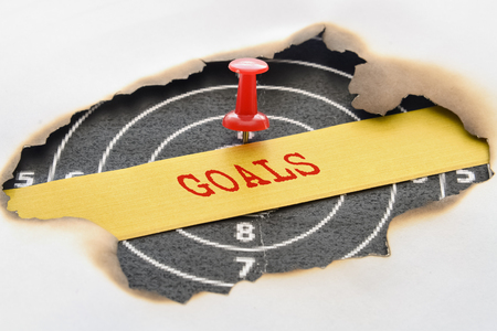 common target: Word Goals written in the center of a pinned target Stock Photo
