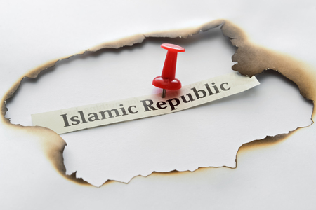 Text Islamic Republic pinned in the center of the target Stock Photo