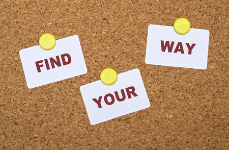 find your way: Text Find Your Way on white stickers pinned on cork board