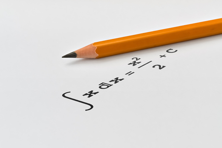 Yellow pencil and integral of a function on bright background