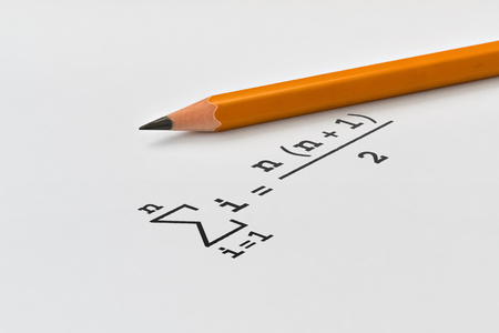 Yellow pencil and sum of a series of integers on bright background
