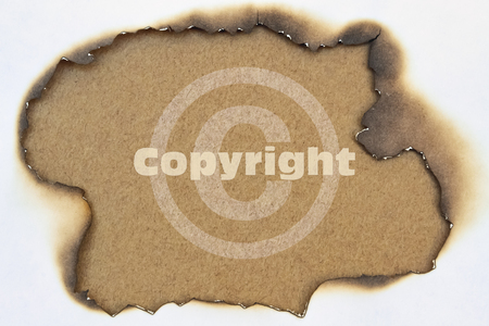 Copyright symbol and word Copyright written on burnt paper