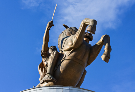 Bronze monument of Alexander the Great in Skopje and blue sky