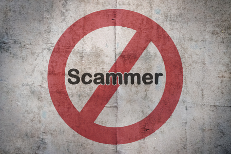 Word Scammer written over a traffic sign on vintage background Stock Photo