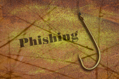 Word Phishing written on grunge background and a fishing hook