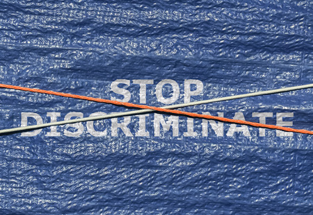 Text Stop Discriminate and rope over it written on blue background Stock Photo