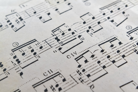 Closeup of a music sheet written for classical guitar