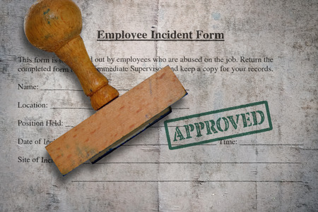 Employee incident form and rubber stamp on vintage background