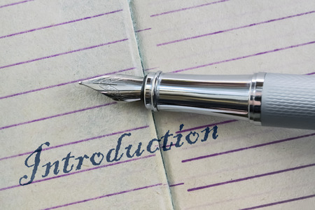Closeup of a fountain pen and word Introduction written in script letters