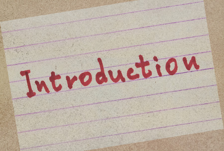 Word Introduction handwritten on a paper in red color
