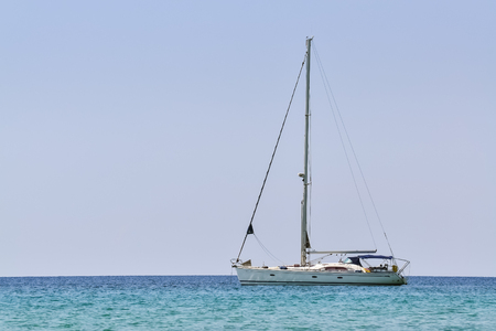 Sailboat in the sea and clear blue sky in the background